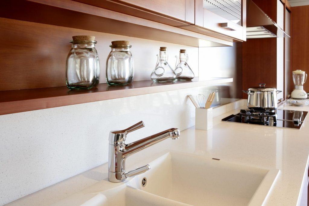 a white tile kitchen sink