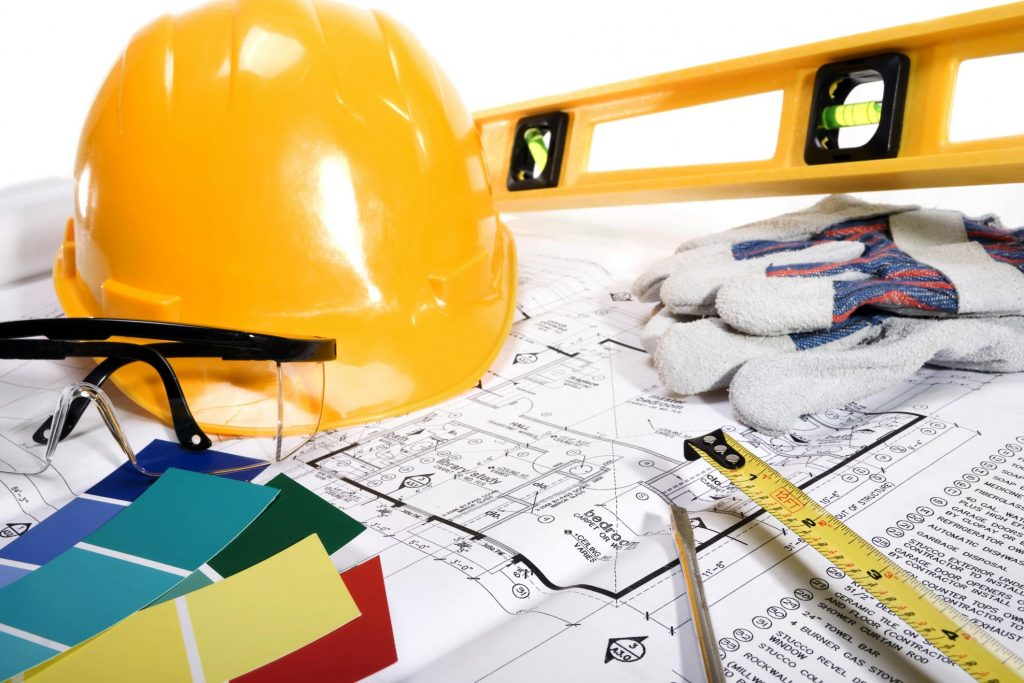 a hard hat and a blueprint